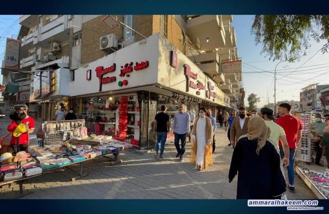السيد عمار الحكيم يتجول في منطقة الكراده وسط بغداد